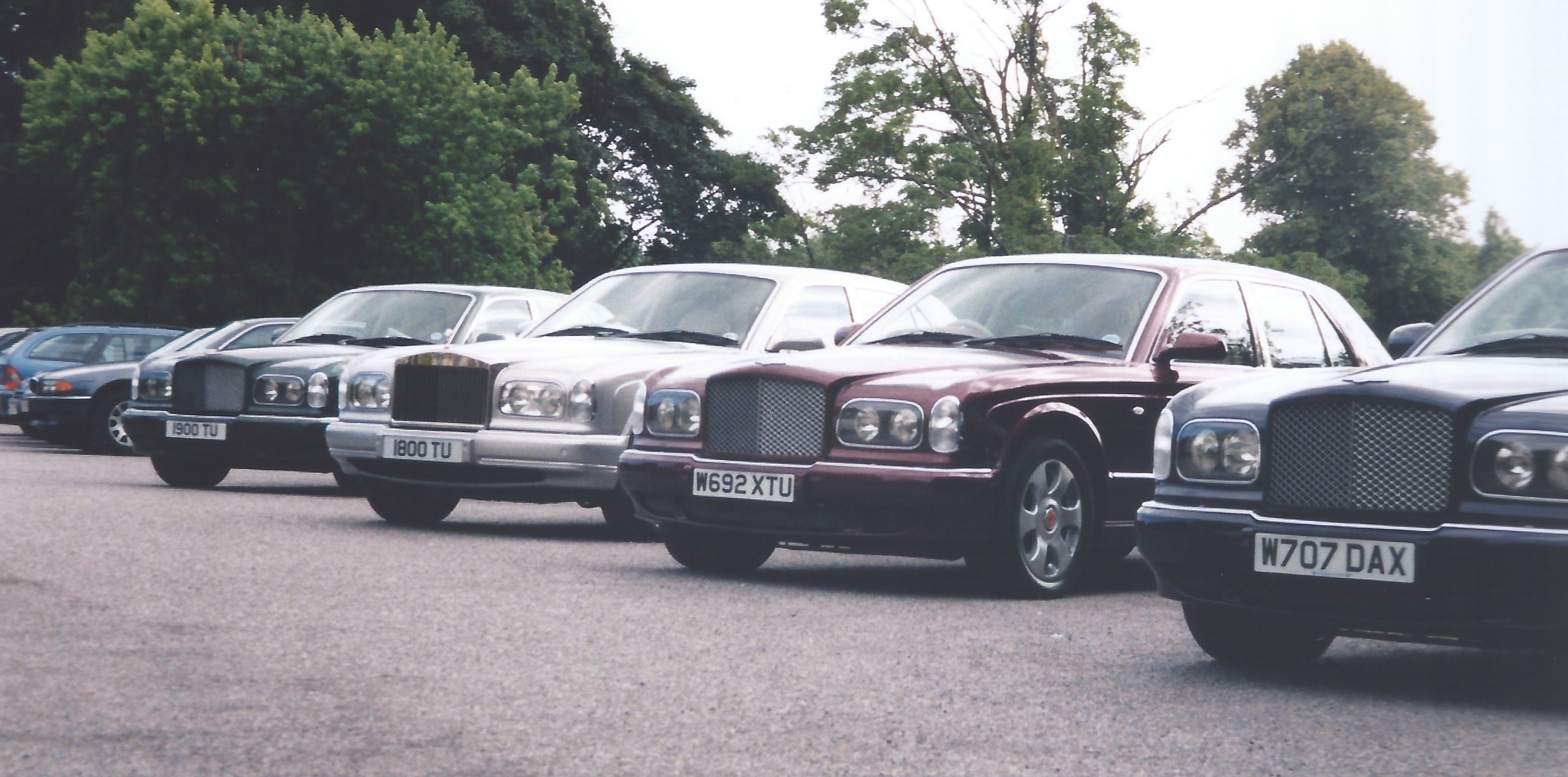 A row of four Bentley Arnages in various colours