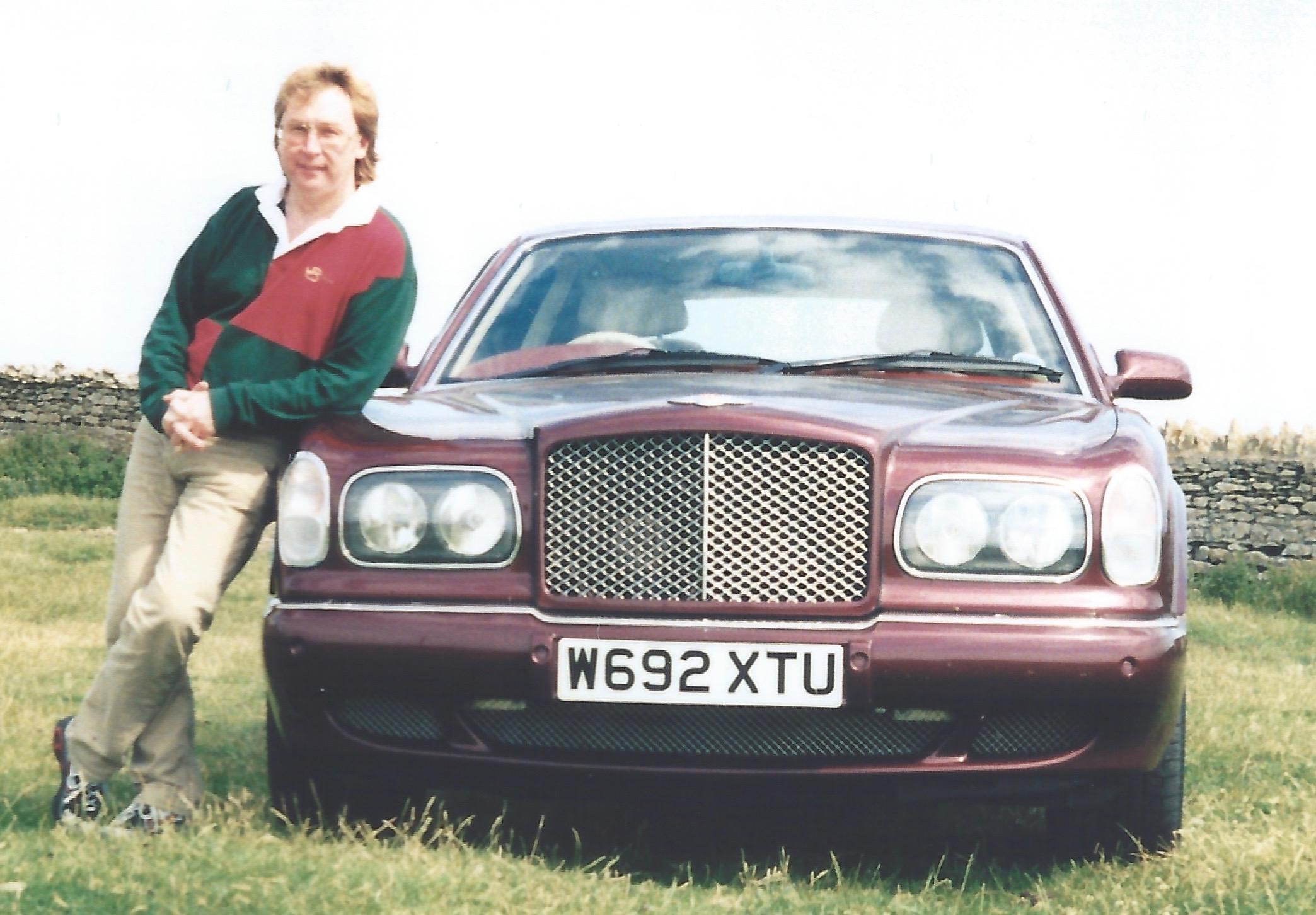 Image of the author stood next to a Bentley Arnage