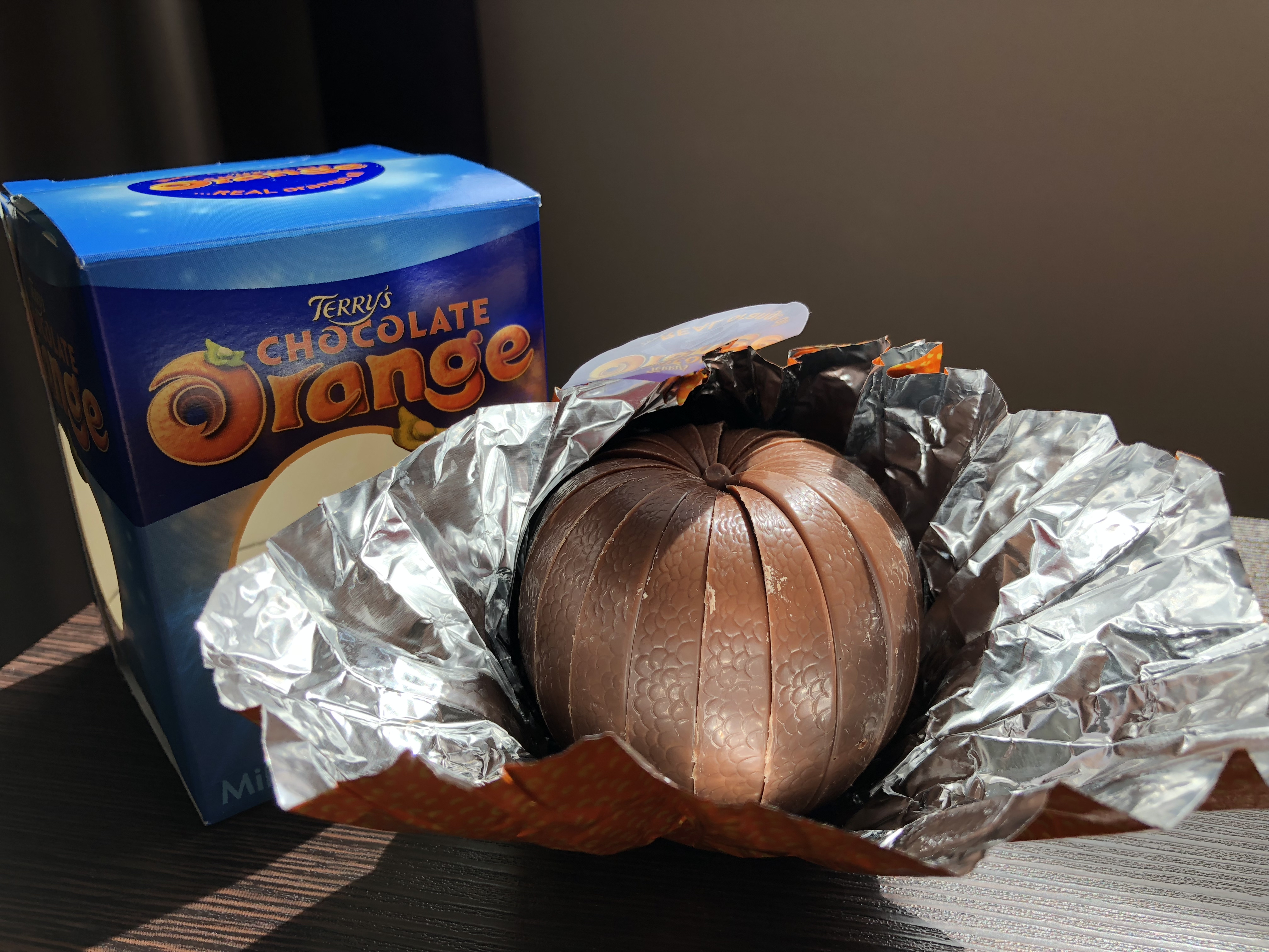 A partially unwrapped standard Terry's Chocolate Orange