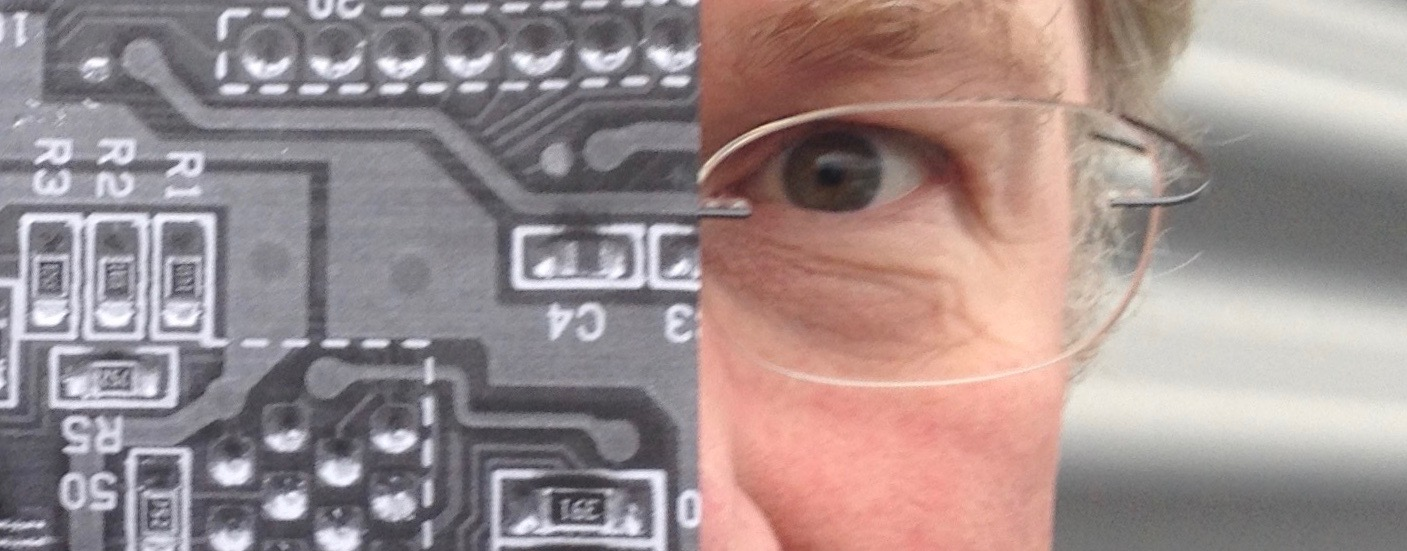 A photograph of Vince half covered by a photograph of a circuit board