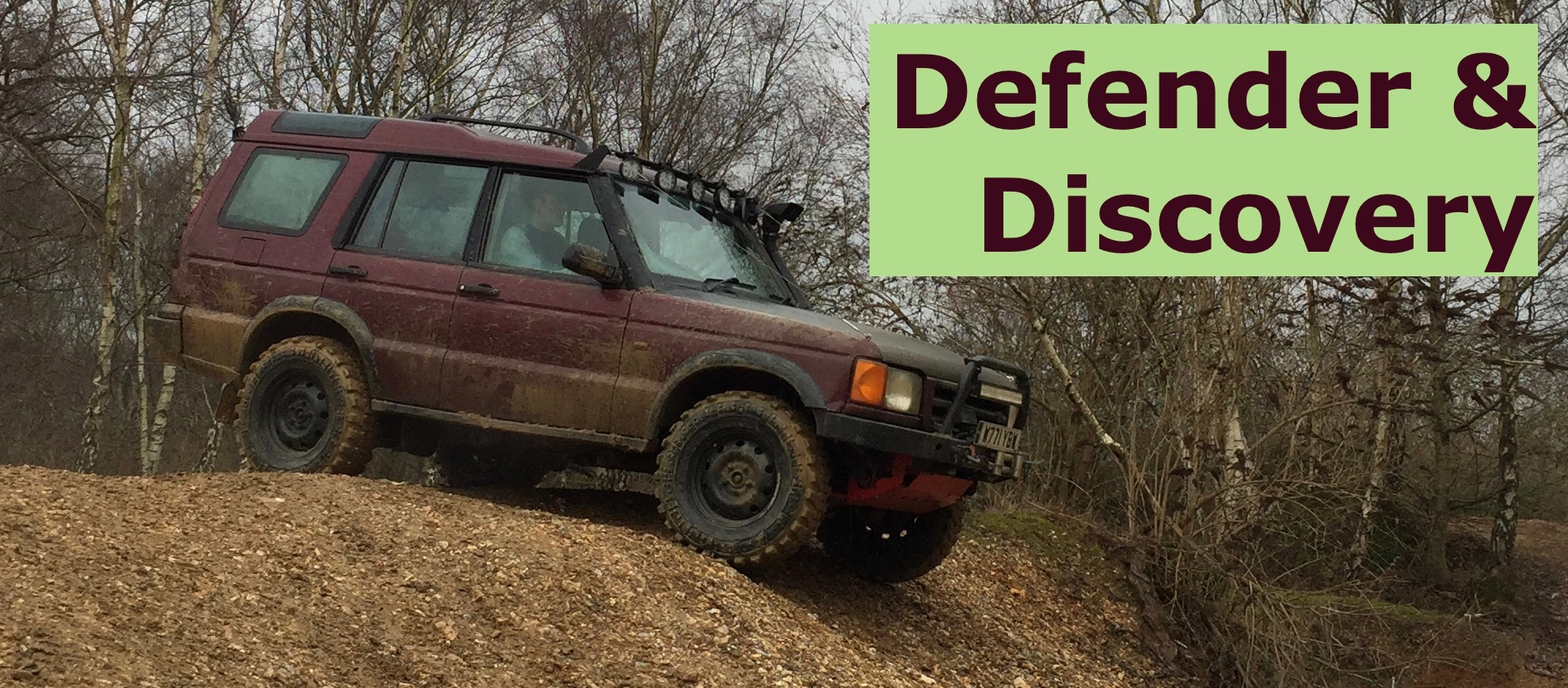 The title card showing a photograph from an offroad day showing an offroad modified Land Rover Discovery Series 2, model designation L318, in red atop a muddy hill about to descend.