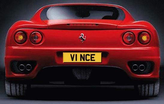 A photoshopped rear view of a red Ferrari 360 prominently displaying the registration number plate V1 NCE