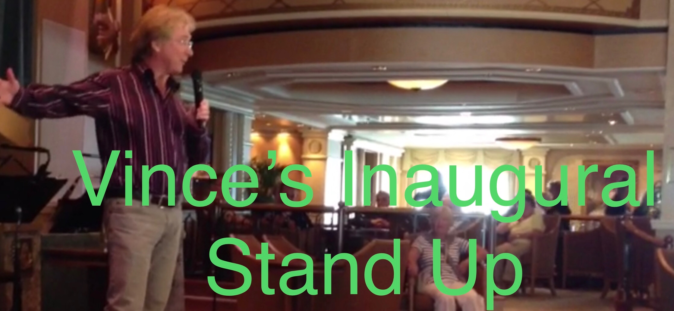 Image of Vince performing his inaugural stand up routine on board Queen Elizabeth