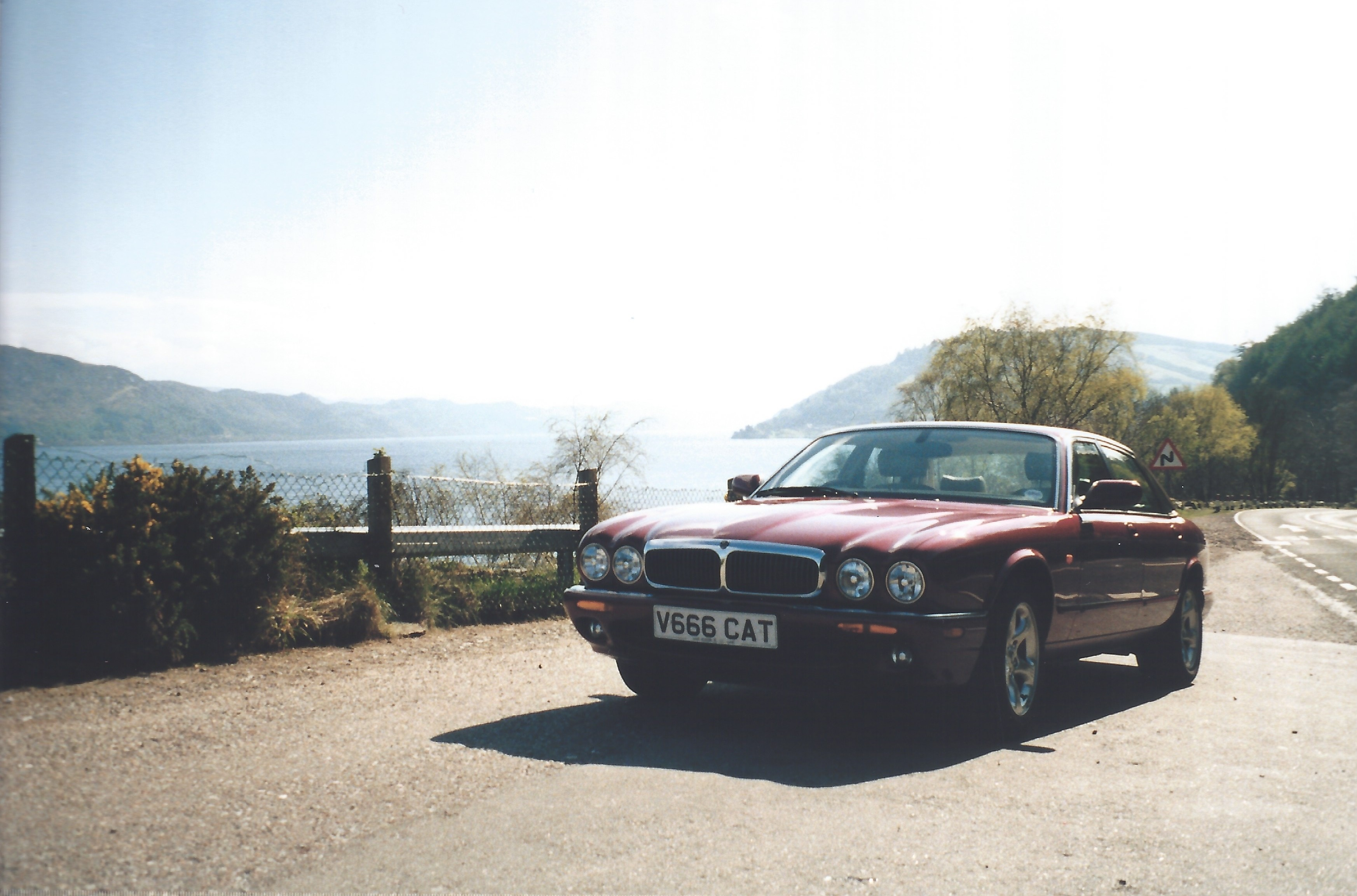 Photograph of a Jaguar XJ8 parked on the shores of Loch Ness