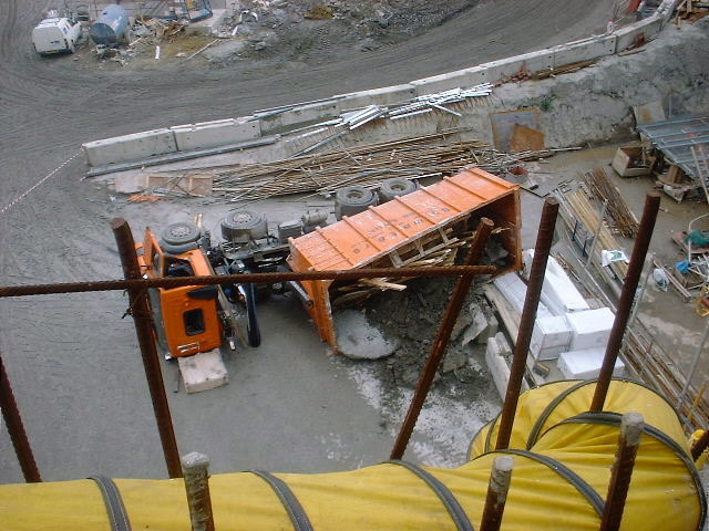 Image of a lorry on it's side on a building site