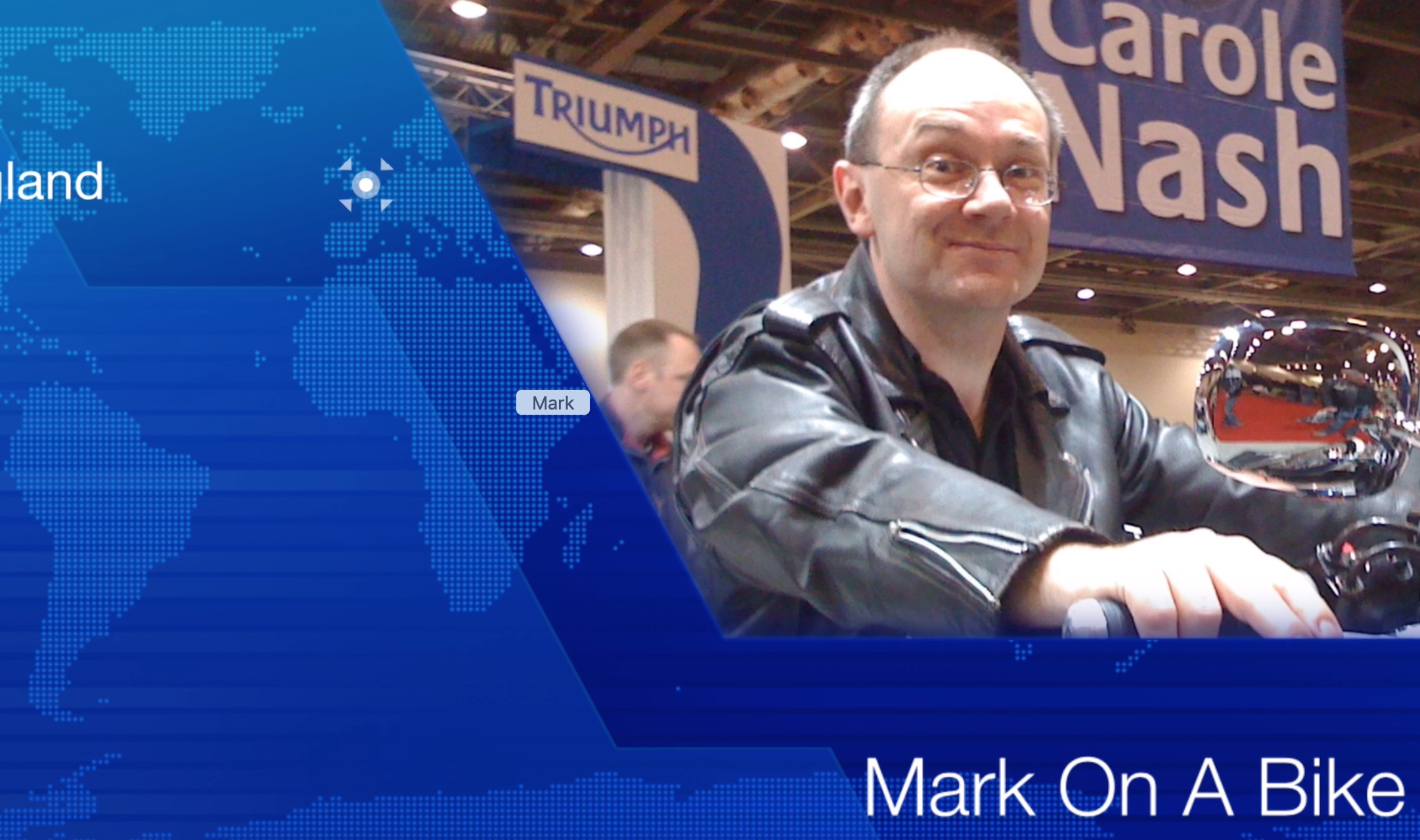The title card from my short video entitled Mark On A Bike showing a still shot from the video title sequence showing a close up of Mark on a cruiser style motorcycle in his leather jacket with blue title graphics.