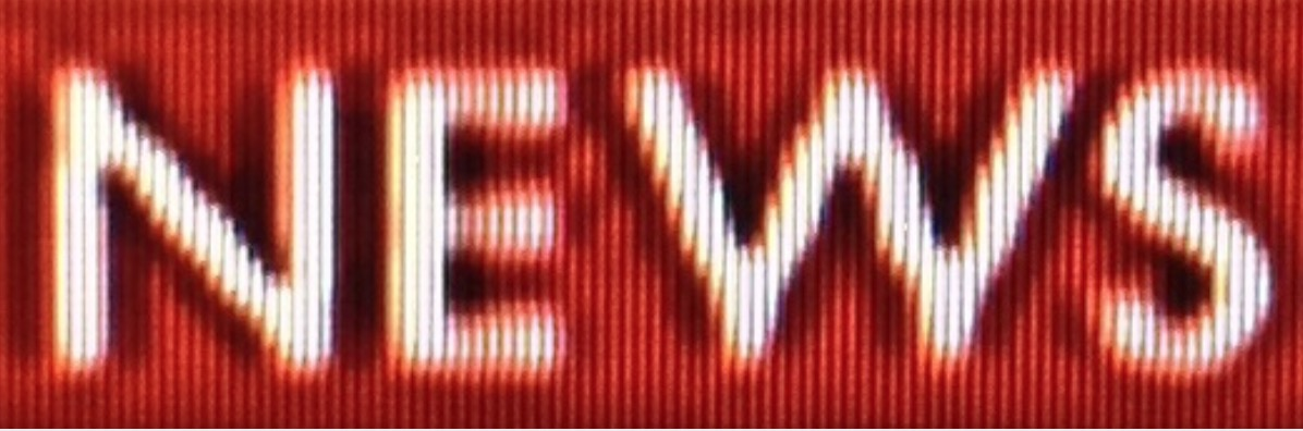 A screenshot closeup of the word News in white on red taken from a Sony Trinitron source with high pixelation