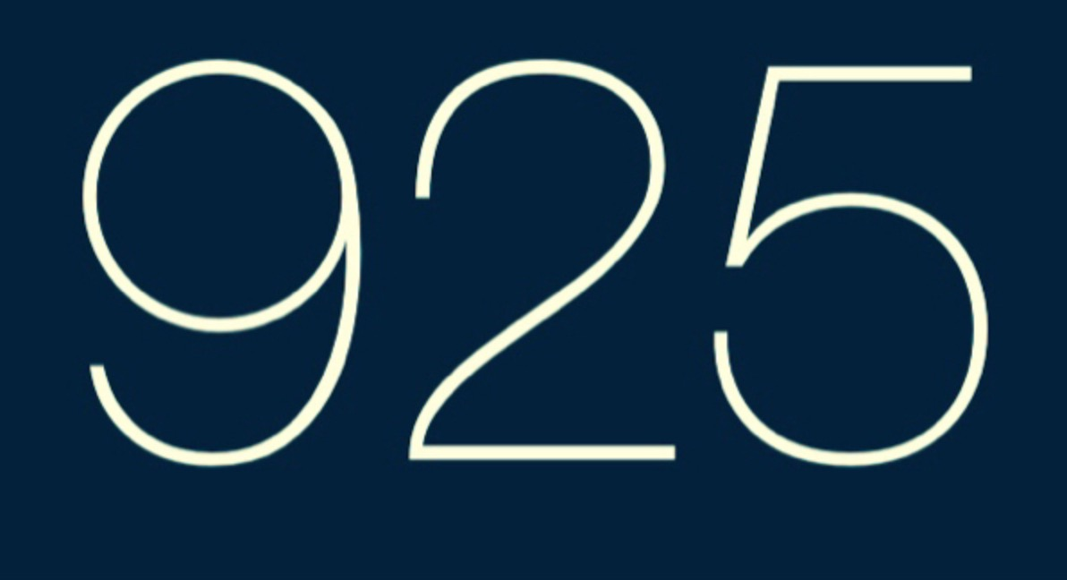 A simple rectangular blue box with a delicate white font showing the number 925