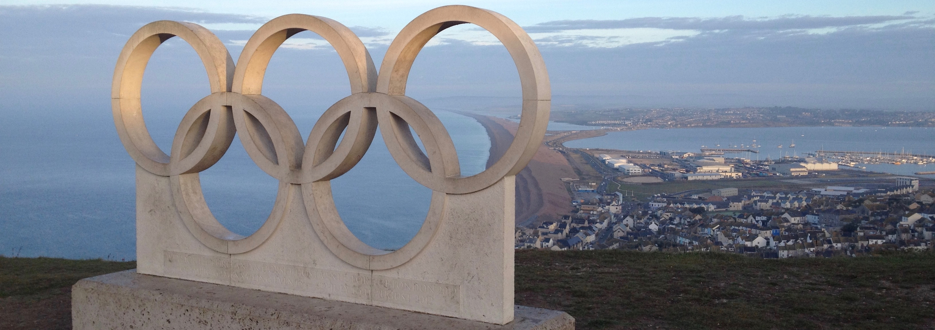 The concrete, interlocking, five Olympic rings high on a hill overlooking Portland