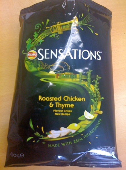 A packet of roasted chicken and thyme Walkers crisps from their Sensations range with a typed claim stating - Made with real ingredients
