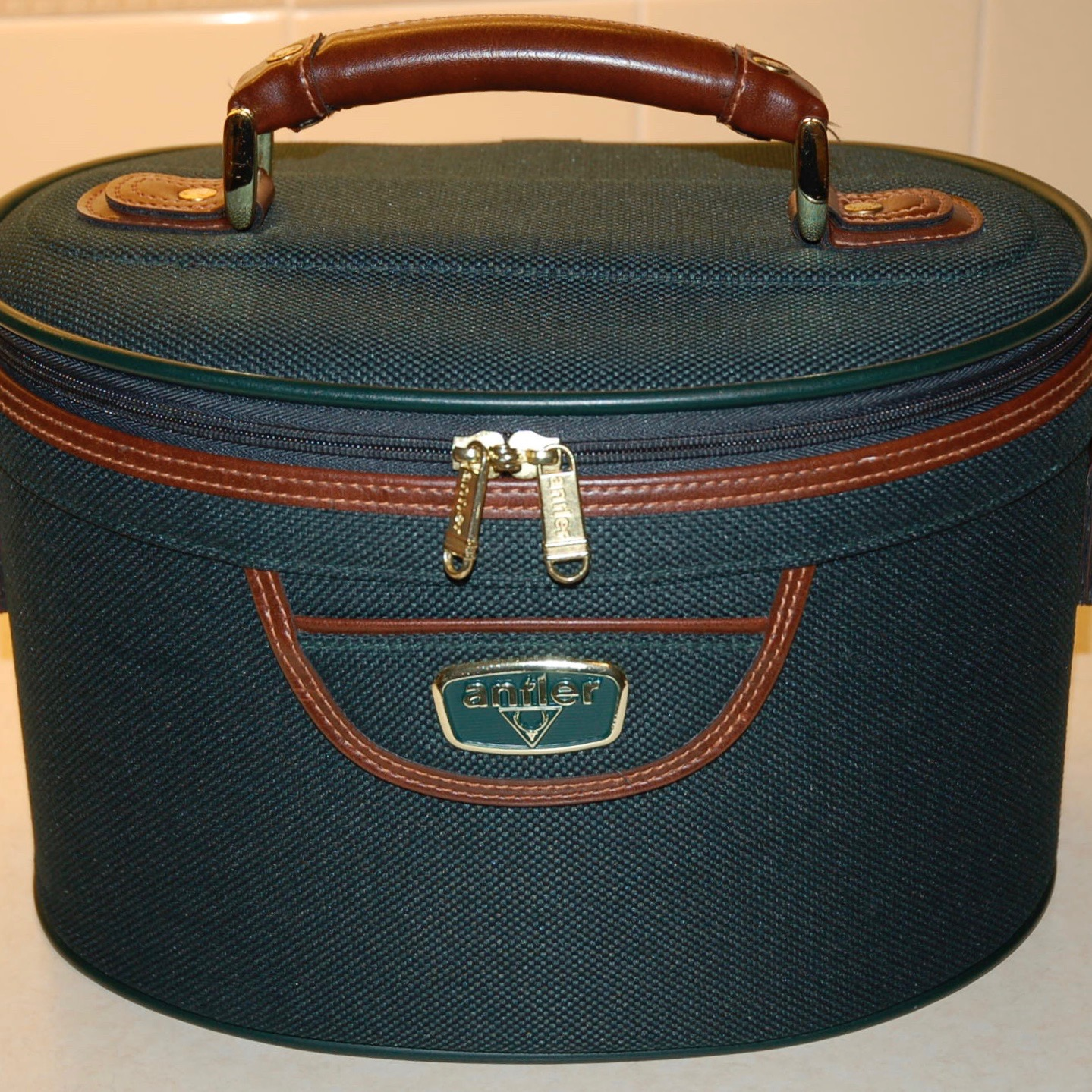 Photograph of a green oval vanity case