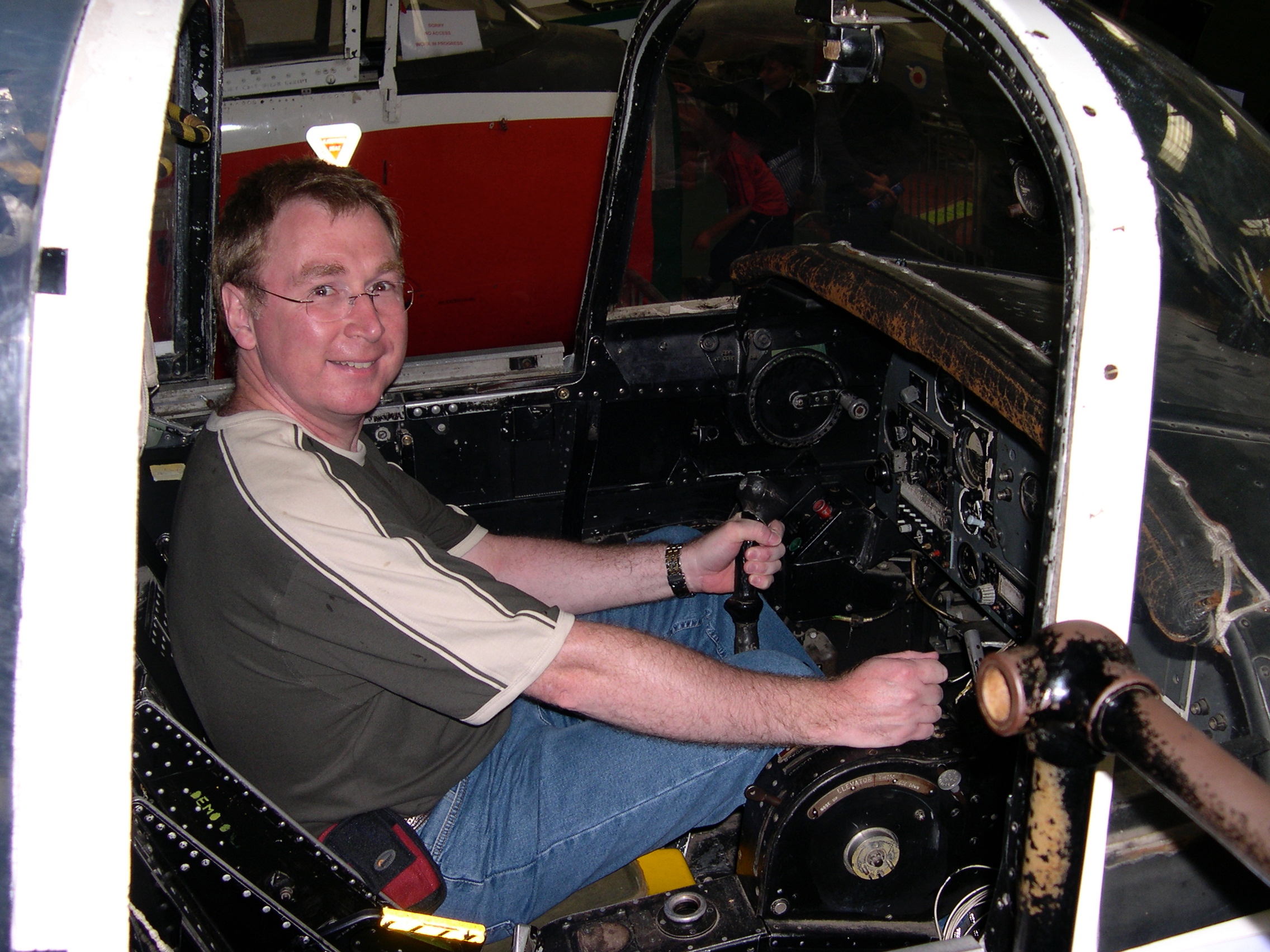 Vince Poynter sat in a old aircraft trainer cockpit