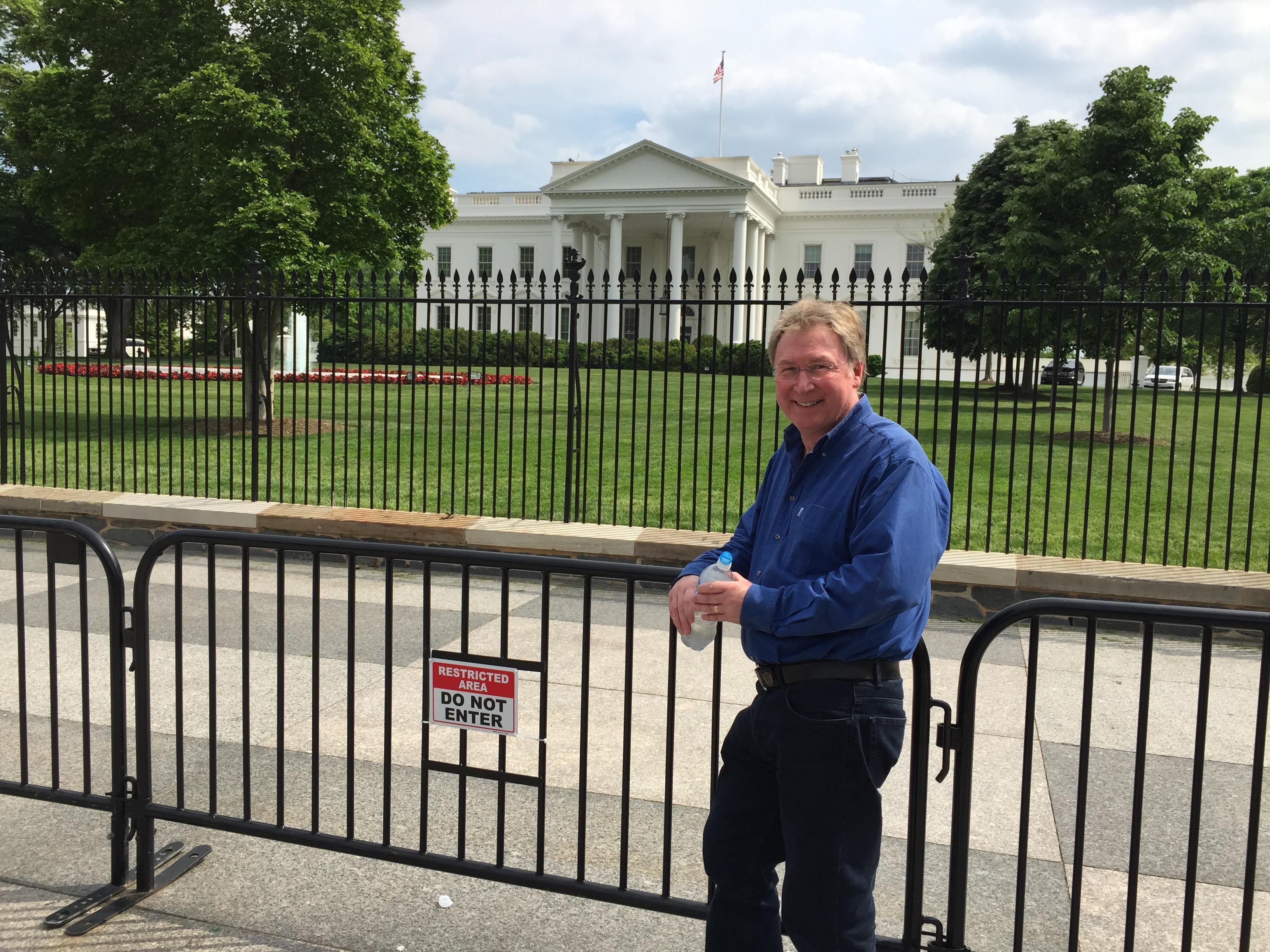 Vince stood against the barriers outside the White House