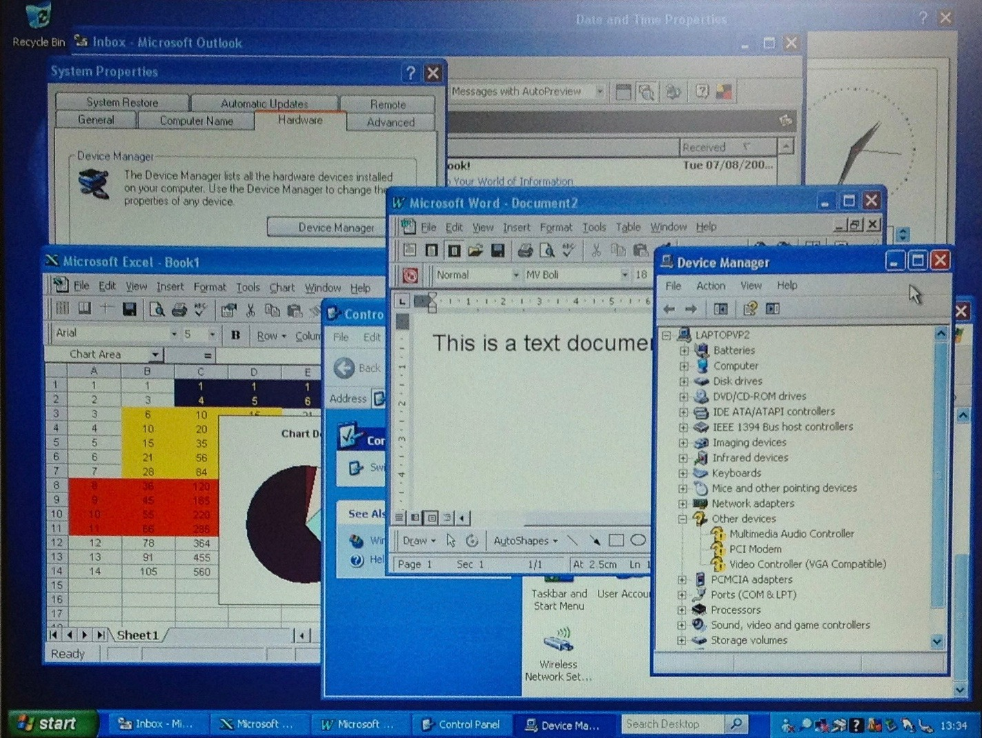 Screenshot of laptop running multiple Windows in Windows XP